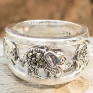 Sterling silver band with elephants